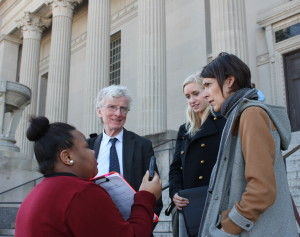 Outside court building, McDonogh #35 student interview's Robert McDuff (l to r), Kristin Wenstrom, and Emily Maw. Attorneys from ipno ( Innocence Project New Orleans ) representing the Defense.